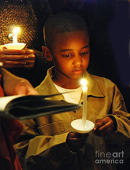 Boy by candlelight by Jim Wright