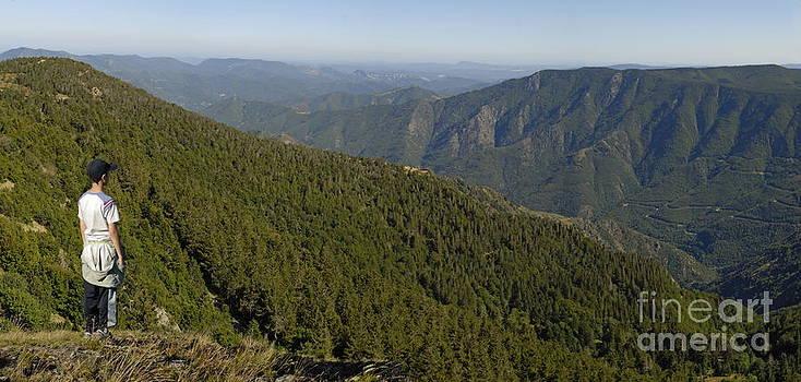 Sami Sarkis - Boy looking at mountain range from Mount Aigoual