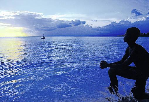 Johnny Sandaire - Boy sitting at sunset