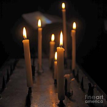 BERNARD JAUBERT - Candles burning in a church