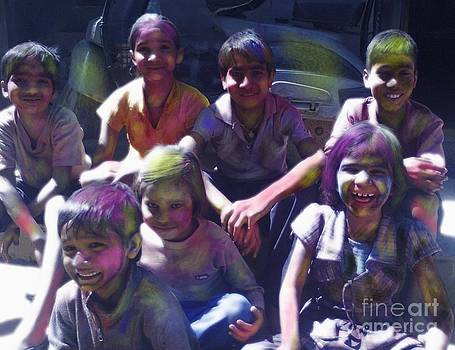 Children enjoy the festival of Holi by Ravi Kumar