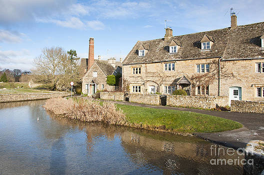 Cotswold village  by Andrew  Michael