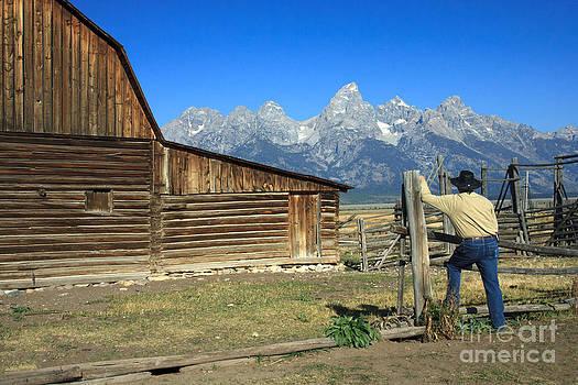 Cowboy with Grand Tetons Vista by Karen Lee Ensley