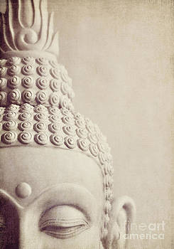Cropped stone Buddha head statue by Lyn Randle