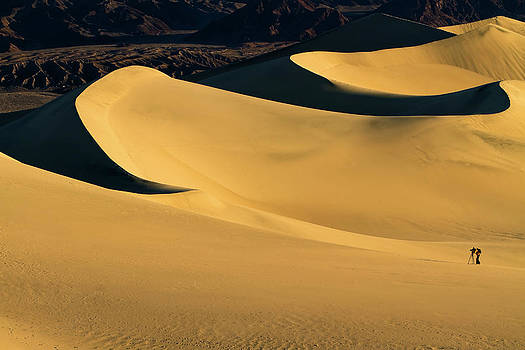 Death Valley and photographer in morning sun by William Lee