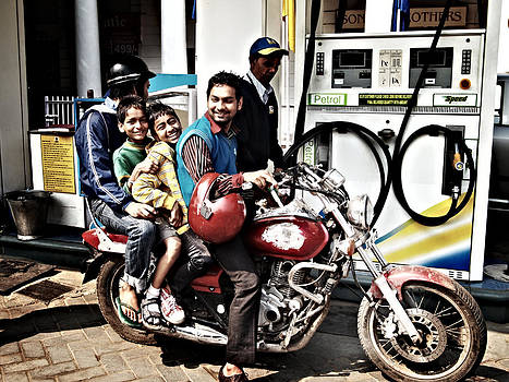 Family on the motorcycle by Guillaume Rodrigue