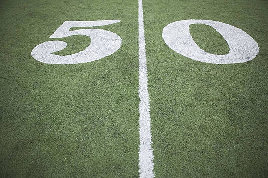 Fifty Yard Line On Sports Field by O'Brien Productions