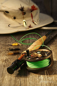 Sandra Cunningham - Fishing reel and hat on bench