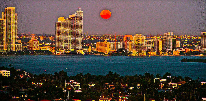 Full moon/sun rise over Miami by Ronald  Bell