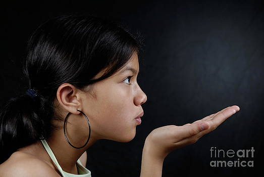 Sami Sarkis - Girl blowing palm of hand