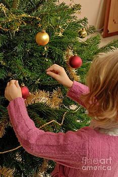 Sami Sarkis - Girl decorating Christmas tree