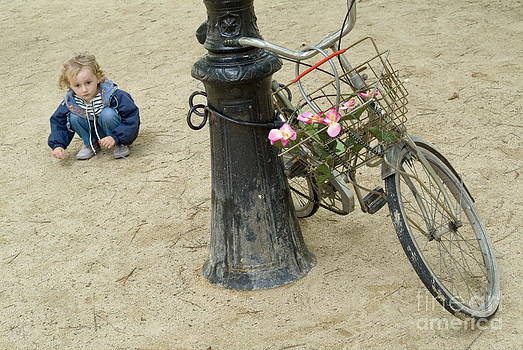 Sami Sarkis - Girl playing with sand near bicycle