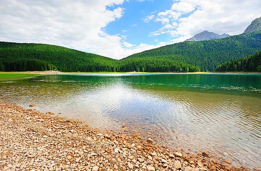 Glacial Black lake in Durmitor  by Roman Rodionov