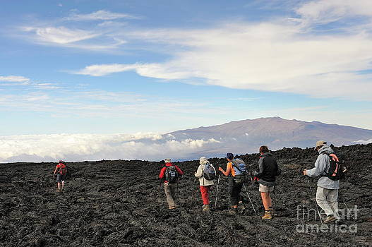 Sami Sarkis - Group of hickers walking on cooled lava