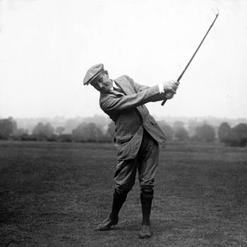 Harry Vardon swinging his golf club by International  Images