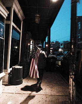 Homeless Man Carrying American Flag in New Orleans by Louis Maistros