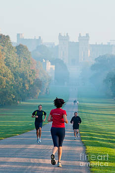 Joggers at Windsor by Andrew  Michael