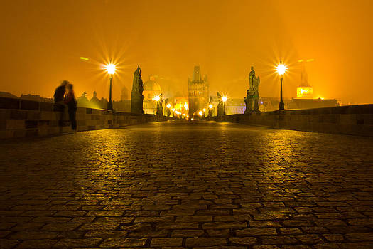 Kissing on the Charles Bridge Prague by Les Abeyta