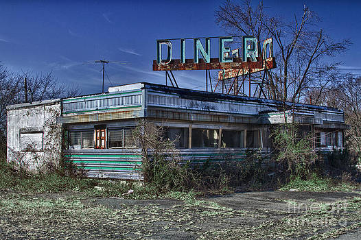 Late for dinner. Abandoned empty diner. by Robert Wirth