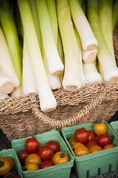 Leeks And Tomatoes At A Market Stall by Taylor S. Kennedy