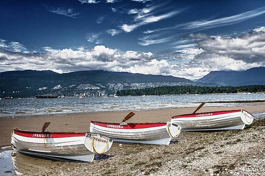Life boats on the beach by Scott Holmes