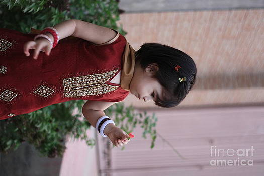 Little girl with flower by Muhammad Junaid Rashid