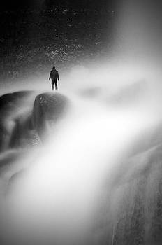Man at waterfall by Micael  Carlsson