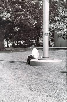 Man Resting at Pole by Floyd Smith