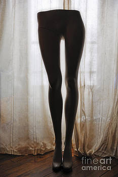 Sami Sarkis - Mannequin legs standing by window
