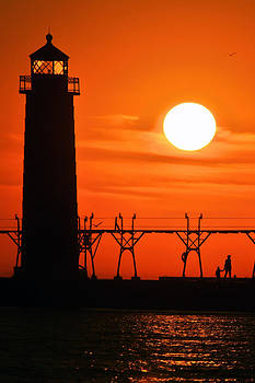Mother and Child Sunset Walk by Lighthouse by Jeramie Curtice