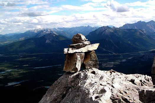 Mountain top inukshuk by Jonathan Lagace