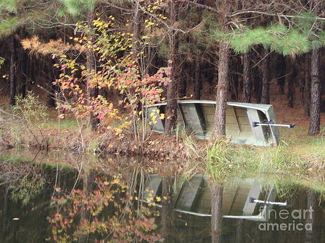 Old fishing boat by a pond by Cindy Hudson