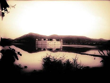 Palace on water covered by mountains  by Prashant Upadhyay