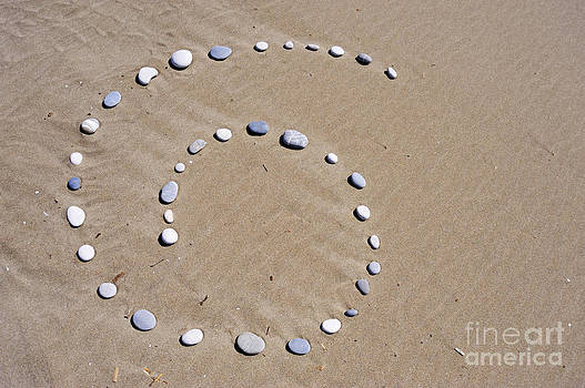 Sami Sarkis - Pebbles arranged in spiral shape on beach