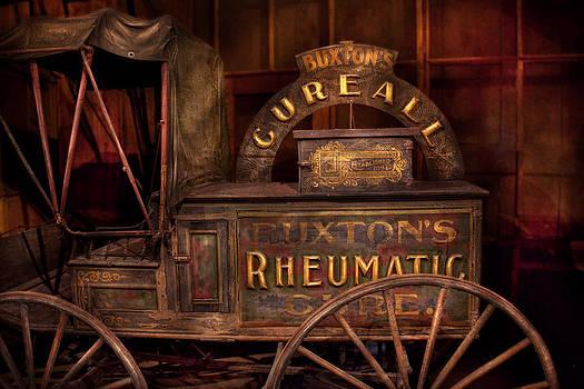 Mike Savad - Pharmacy - The Rheumatic Cure wagon