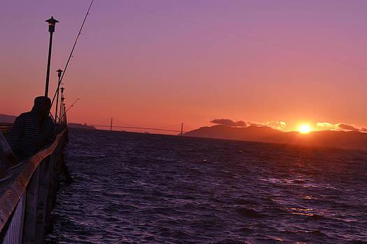 Picking Through The Bridge Sunset by Saifon Anaya