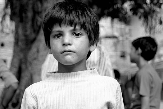 Portrait Of Young Innocent Boy by Karan Anand