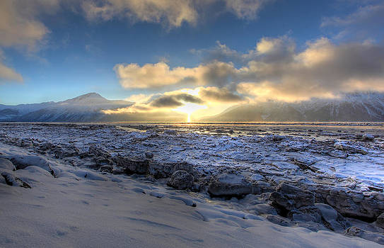 Ray Of Light Over Frozen Ocean by Wyatt Rivard