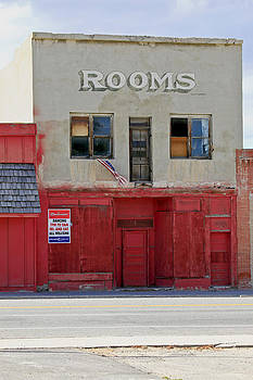 James Steele - Rooms and a beer sign