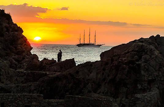 Sailing vessel at sunrise in Taormina by Valerii Tkachenko