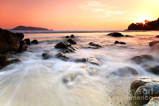 Sea and rock at the sunset. Nature composition.  by Anusorn Phuengprasert nachol