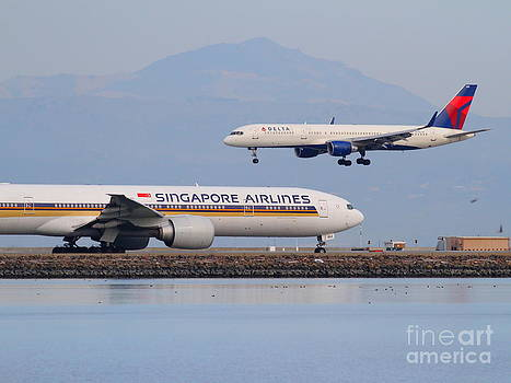 Wingsdomain Art and Photography - Singapore Airlines And Delta Airlines Jet Airplane At San Francisco International Airport SFO