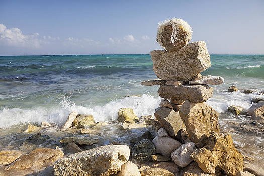 Stacked Rock Figure On The Beach by Bryan Mullennix