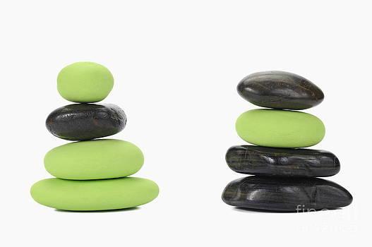 Sami Sarkis - Stacks of green and black pebbles