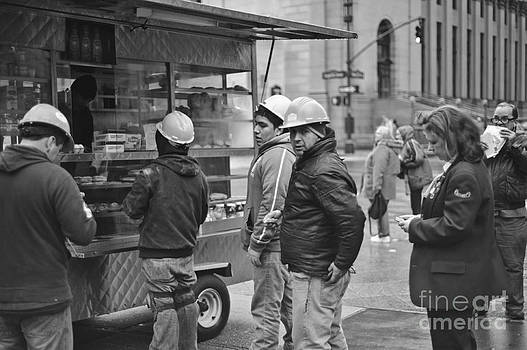 Street Photography - Picking up lunch by Darwin Lopez