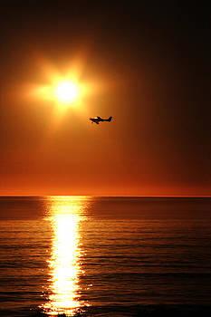 Sun sets on airplane  by Edgar  Mena