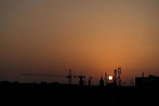 Sunrise over the city by Daniel Kulinski