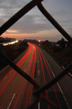 Sunset highway streaking taillights by Rafael Figueroa