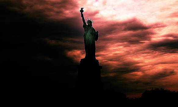 Sunset of Statue of Liberty by Andrey Kopot