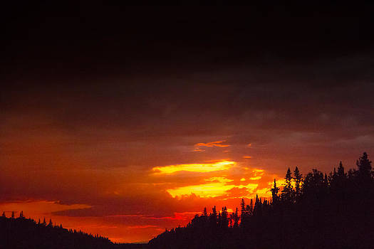 Sunset on a highway by Darren Langlois